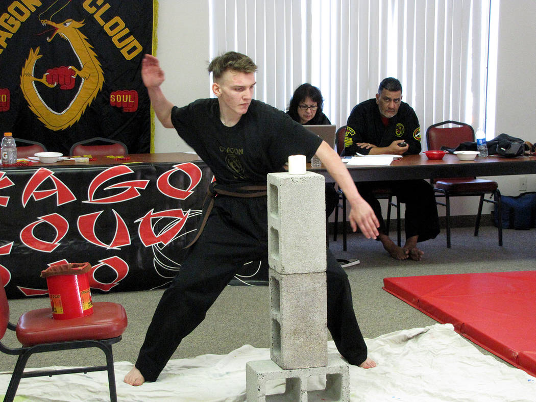 Heather Ruth/Pahrump Valley Times  Jacob McKnight strikes a flame from a candle. McKnight was one of three black belt candidates that were tested in Pahrump from Dragon Cloud Dojo on April 21.