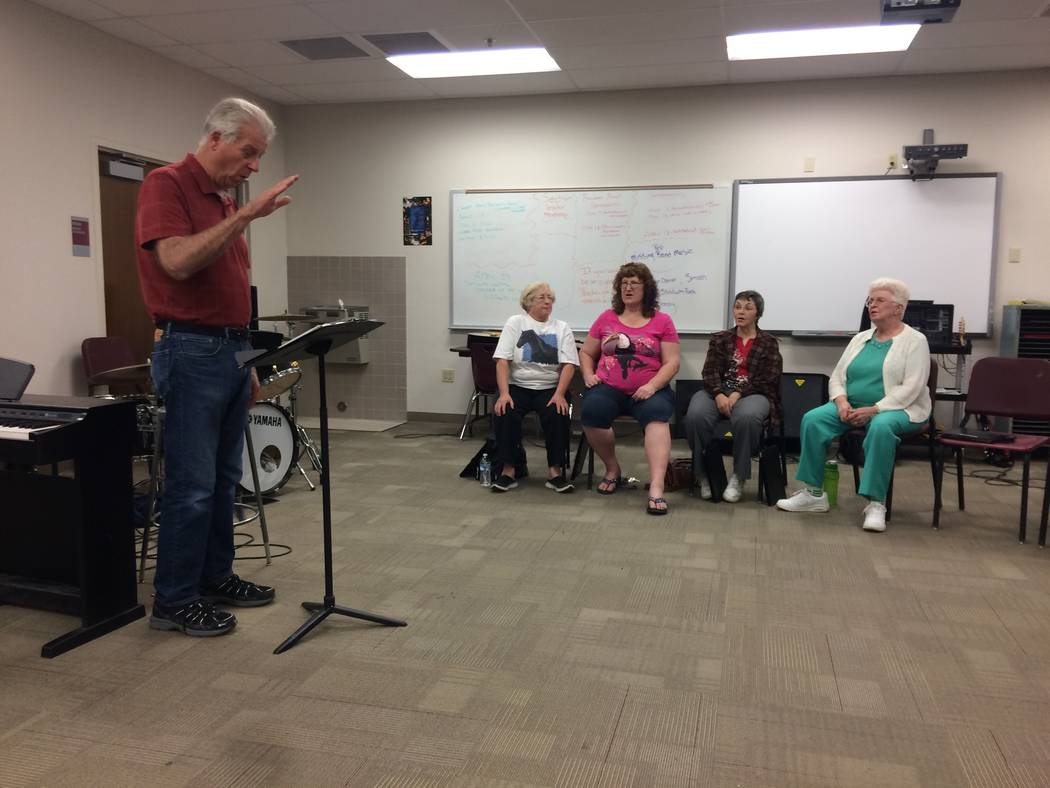 Photos by Vern Hee/Pahrump Valley Times  Andy Barnum is seen directing the chorale during practice at the high school. The director for the High Desert Chorale is in his 14th year. The group has b ...