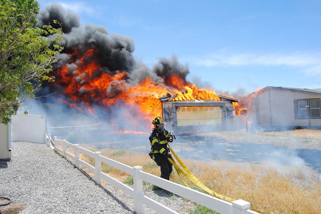 Special to Pahrump Valley Times A wind-driven grounds fire destroyed a detached garage at a residence along the 2300 block of Stardust Street early Tuesday afternoon. One person sustained minor bu ...