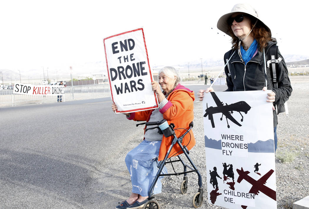 Bizuayehu Tesfaye/Las Vegas Review-Journal Anti-drone warfare protesters, Mary Dean, left, and Lavelle Waters protest outside Creech Air Force Base at Indian Springs on Monday, April 24, 2017, to  ...
