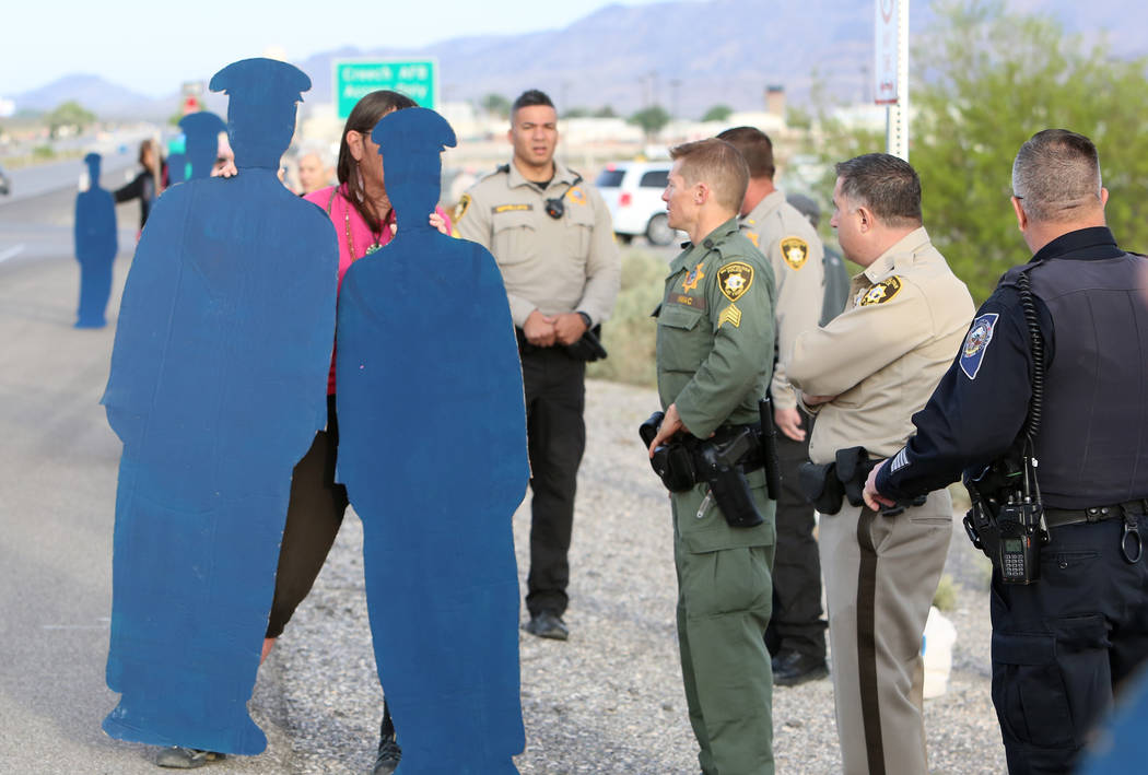Bizuayehu Tesfaye/Las Vegas Review-Journal Anti-drone warfare protester Toby Blome holds life-size cardboard human figures outside Creech Air Force Base at Indian Springs on Monday, April 24, 2017 ...