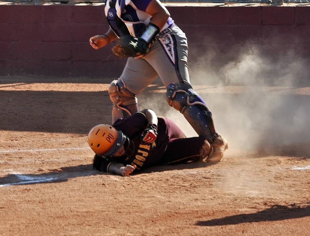 Horace Langford Jr./Pahrump Valley Times  Taylor Eagan slides at home plate against Durango. The Trojans lost to Durango 9-4 in non-league action, but have won their last two league games on the road.