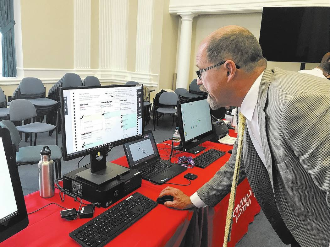 Sandra Chereb/Las Vegas Review-Journal Larry Korb with Dominion Voting shows new voting machine and tabulation technology Wednesday, April 26, 2017 at the state Capitol in Carson City.