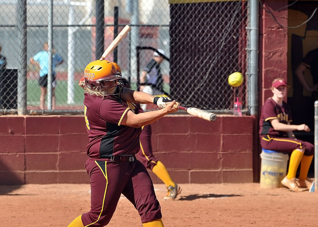 Horace Langford Jr./Pahrump Valley Times Jordan Egan hits one of two home runs that went sailing over the left field fence on Friday. The first one was a three-run home run that got the Trojans st ...