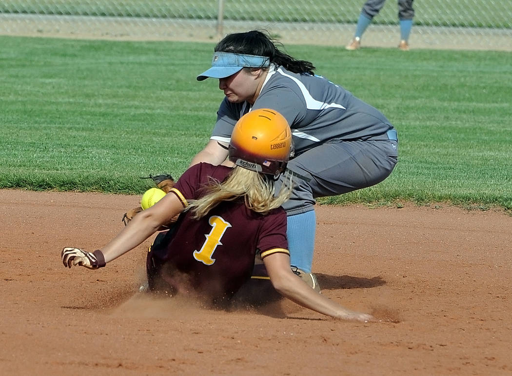 Horace Langford Jr./Pahrump Valley Times Terrena Martin is seen sliding into second base against Western. The Trojans scored 22 runs against the Warriors and the game ended in the fifth inning due ...