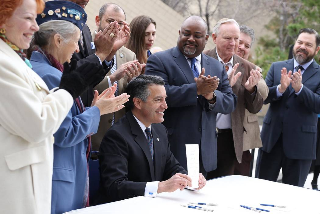 Photo provided by Nevada Governor's Office Nevada Gov. Brian Sandoval signed three bills related to veterans services at a ceremony on the Capitol grounds in Carson City in March.