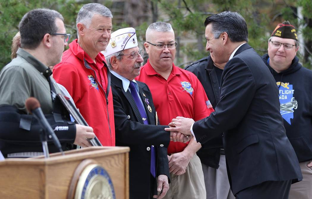 Photo provided by Nevada Governor's Office Nevada Gov. Brian Sandoval presents Veteran Supporter of the Month Award to Honor Flight Nevada at a ceremony in Carson City and March.  In all, Sandoval ...