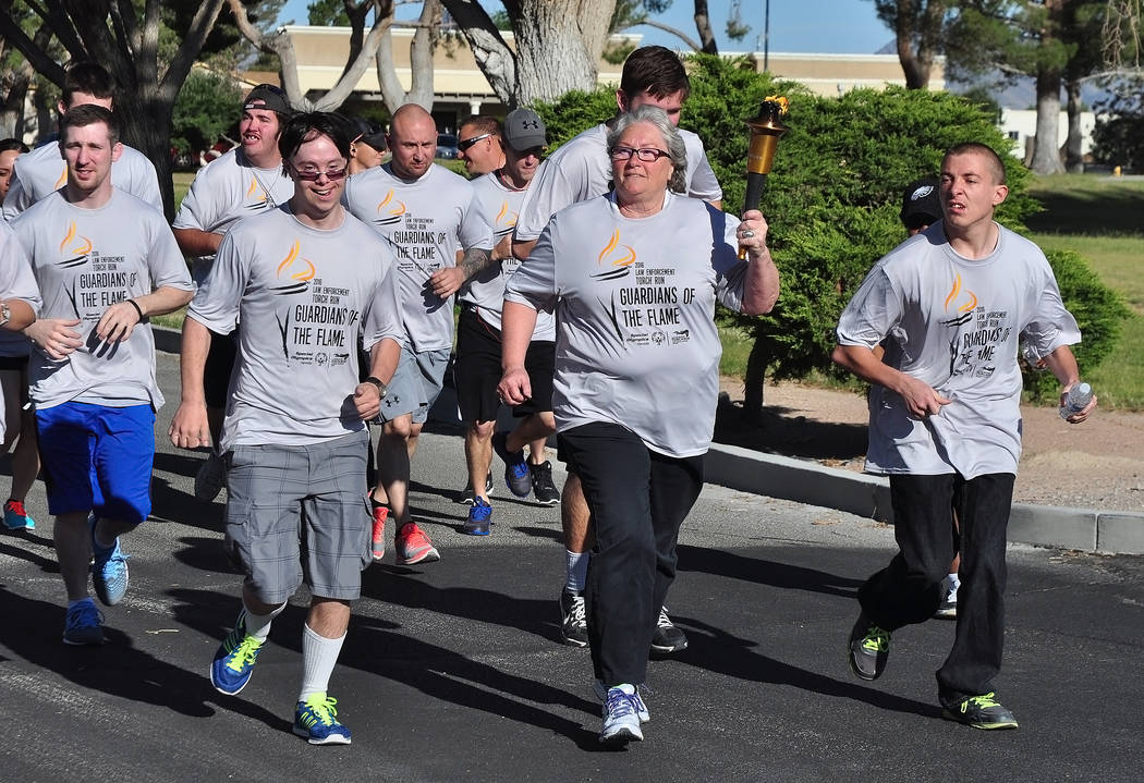 Horace Langford Jr / Pahrump Valley Times Sheriff Sharon Wehrly is seen running with Special Olympics athletes in last year's Torch Run.
