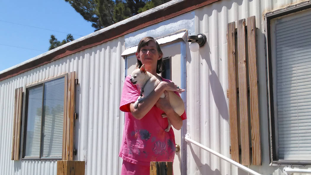 Selwyn Harris/Pahrump Valley Times  Comstock Park resident Valerie Shaw said she's taking active steps to keep her animal out of harm's way after a series of dog poisonings last week. The Nye  ...