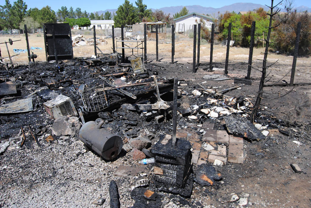 Special to Pahrump Valley Times  On Saturday fire crews were dispatched to the area of Dove and Chucker streets for a wind-driven structure fire just after 12 p.m. Fire crew battled the destructiv ...