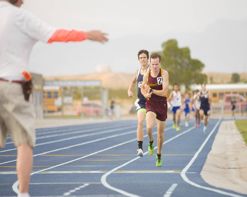 Skylar Stephens/Special to the Pahrump Valley Times  Junior Bryce Odegard toughs it out at the Grant Bushman Invitational on May 5 in Moapa Valley. That day Odegard took first place in the 800-met ...