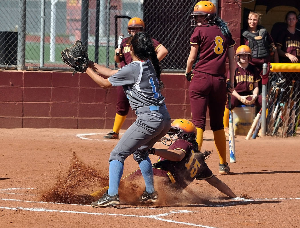 Horace Langford Jr./Pahrump Valley Times Taylor Egan slides safely at home in the game against Western. The Trojans defeated Western 22-7 last week. Egan is one of many talented sophomores on the  ...