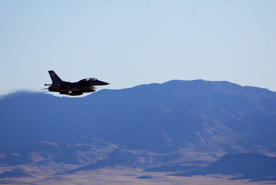 Photo by John Salois An F-16C makes a pass over Nevada's Tonopah Test Range after a March test of a mock nuclear weapon as part of a Sandia National Laboratories life extension program for the B ...