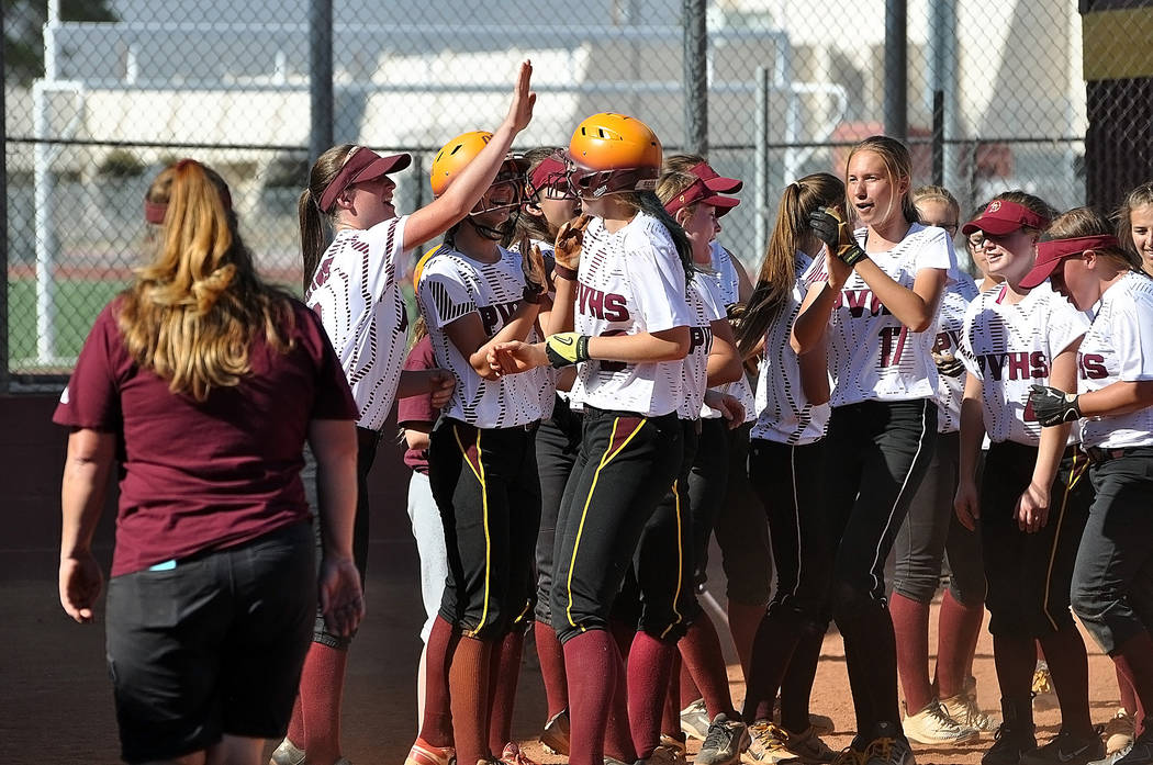 Horace Langford Jr./Pahrump Valley Times Jill Smith is greeted at home plate after her solo home run in the bottom of the second inning.