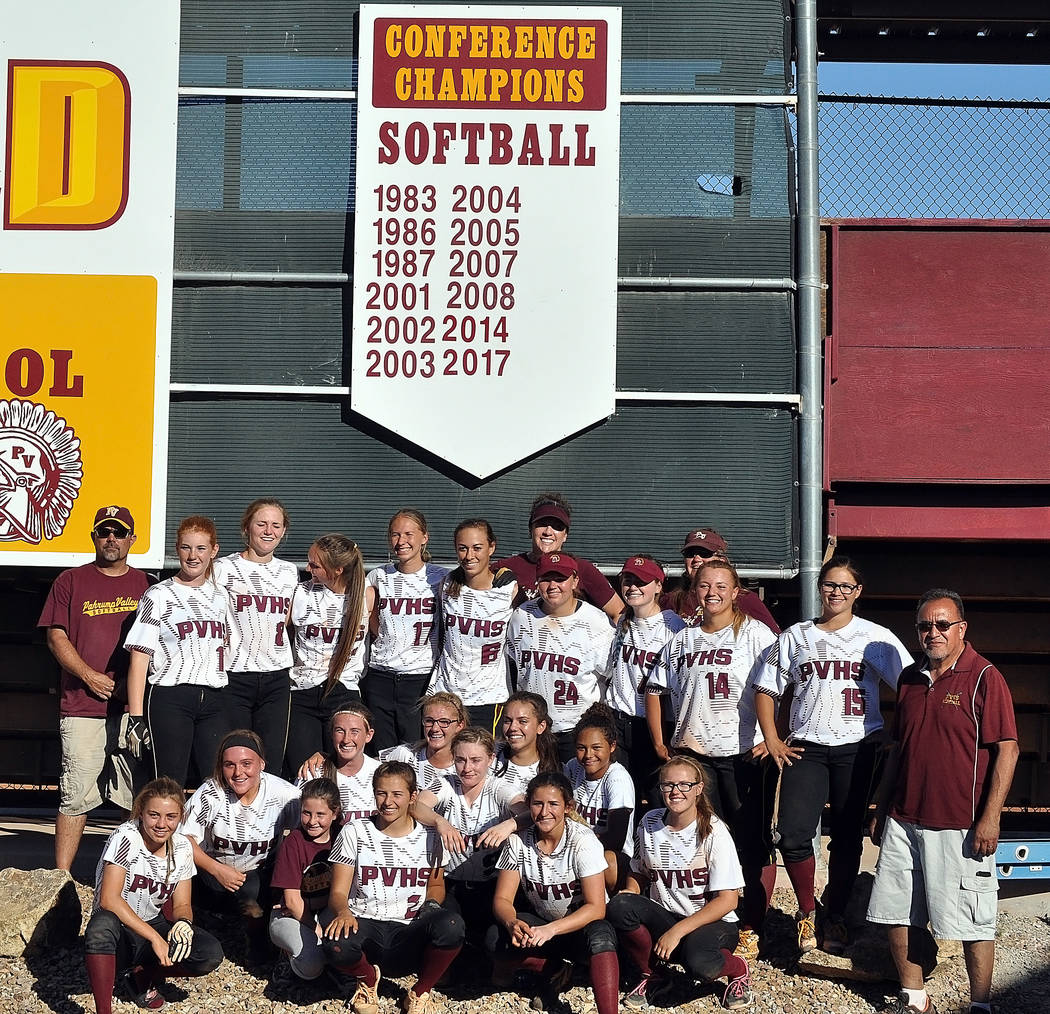 Horace Langford Jr./Pahrump Valley Times The Lady Trojans softball team poses for a photo in front of a sign that lists all their league championships. Note: In 2014 they were not league champions ...