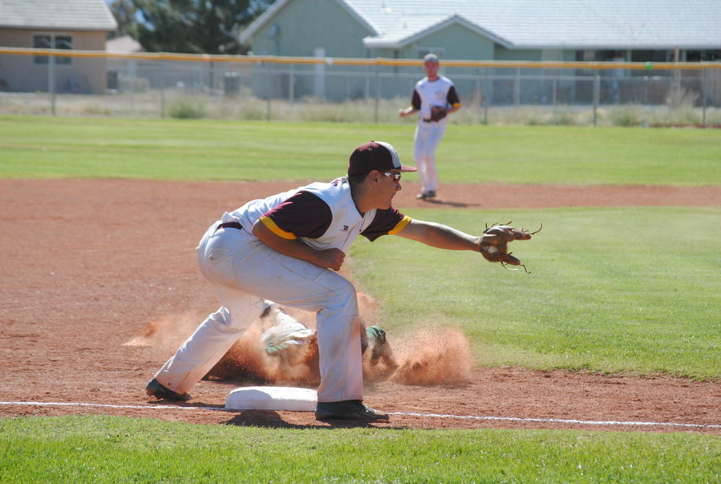 Charlotte Uyeno/Pahrump Valley Times John Macdonald attempts the tag against Mohave runner on May 4. Solid defense kept Mojave off the base pads most of the game.