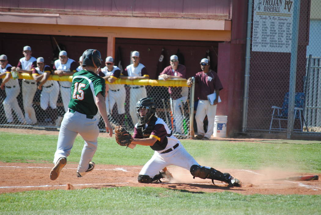 Charlotte Uyeno/Pahrump Valley Times He's out at home. Willie Lucas makes a tag at home from a perfect throw from Parker Hart in left field.