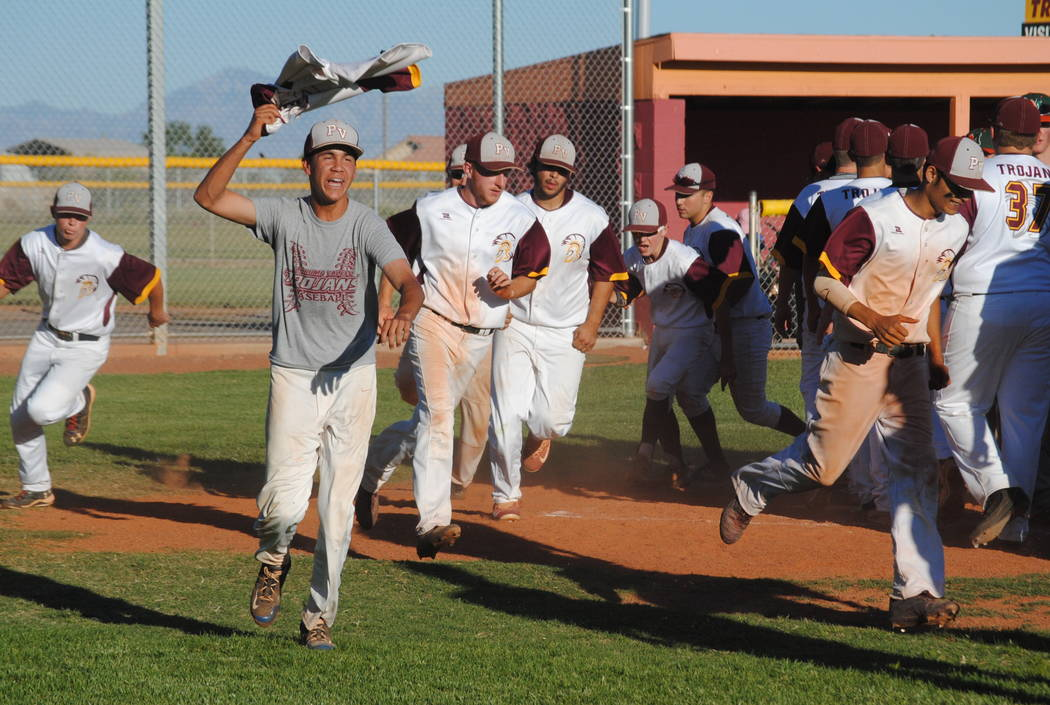 Charlotte Uyeno/Pahrump Valley Times Trojans beat Mojave last Thursday to win the league title and a celebration on the field ensued. It was the first time since 2001 that the Trojans won the leag ...