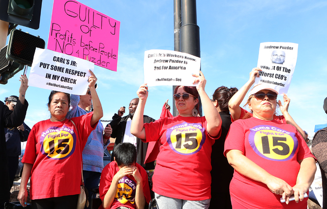 Bizuayehu Tesfaye/Las Vegas Review-Journal Petrade Santos, left, Irma Calzadillas and Bertha Nabarro joined other workers fighting for a minimum wage protest outside of a Carl's Jr. on 2100 Fremon ...
