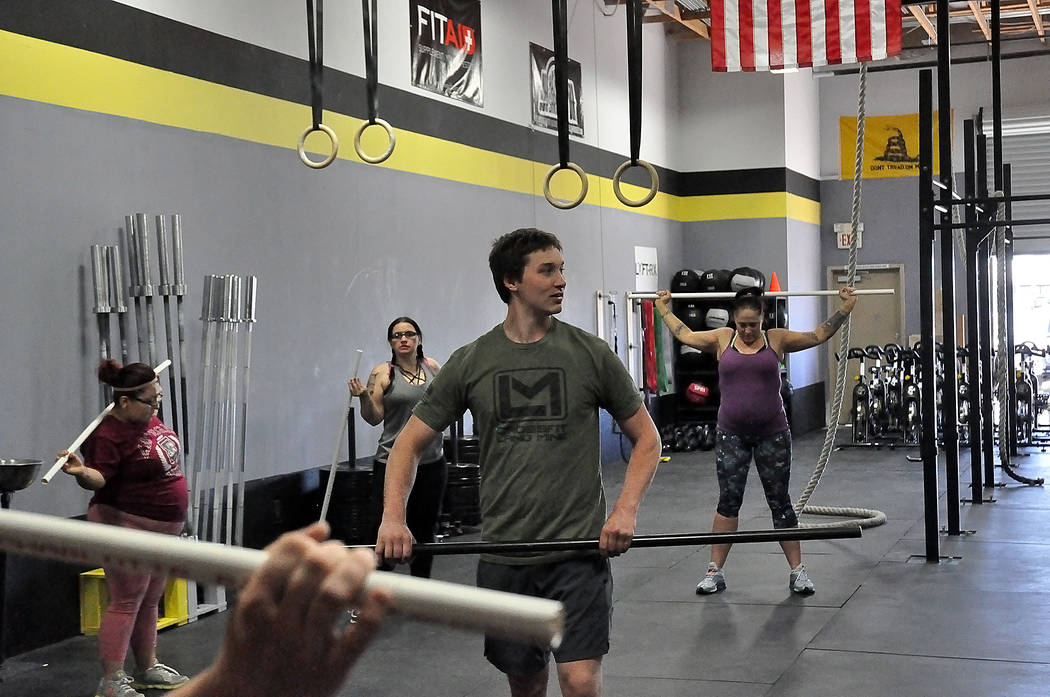 Horace Langford Jr./Pahrump Valley Times  Maria Melendez (far left) at the start of her six weeks of training, listening to her coach, Zach Merath, bark out commands. She hated the first week but  ...
