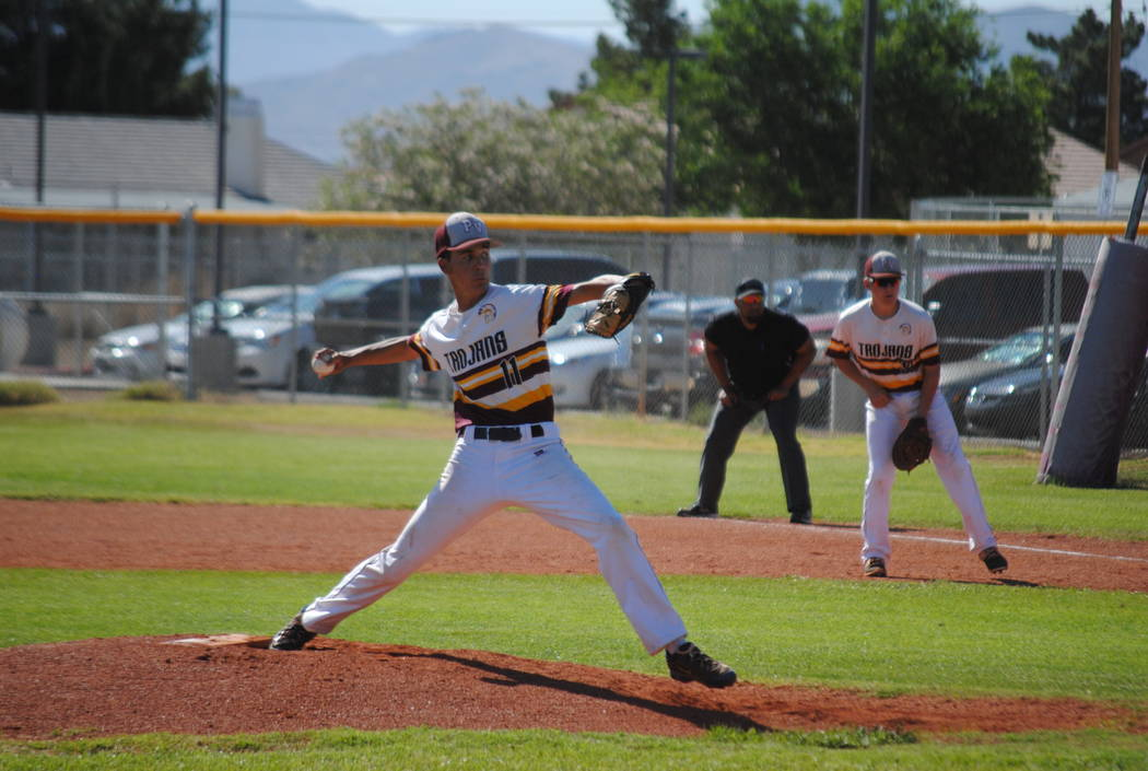 Charlotte Uyeno/Pahrump Valley Times  Senior Trojans Pitcher, Josh Ferrer, gets his second win in a row as he pitches a good solid four innings against Desert Pines on Wednesday before Trojans coa ...