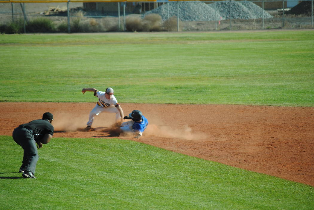 Charlotte Uyeno/Pahrump Valley Times  Drew Walker gets the out with the steal attempt at second base against Desert Pines.