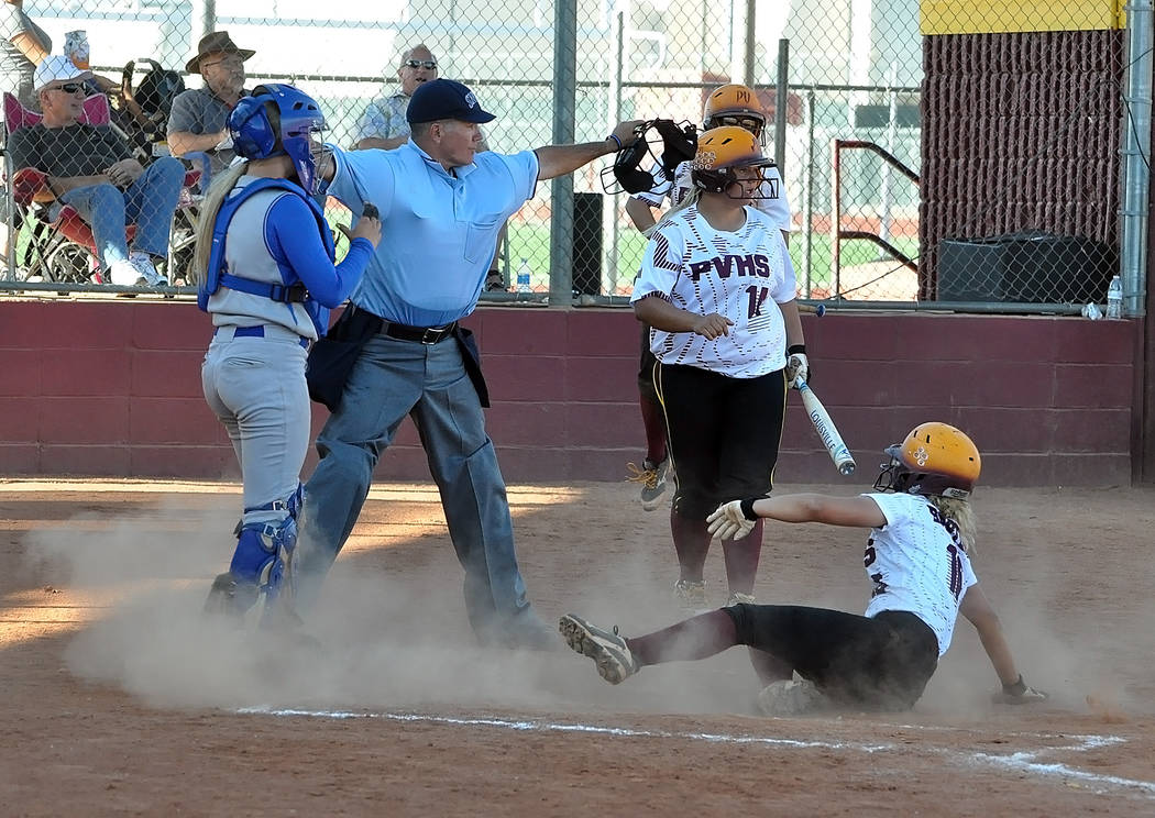 McKayla Bartley sliding home for a steal. The Trojans stole home on a throwing error by the catcher, which allowed two runners to cross the plate in the sixth inning, wining the game for the Trojans.