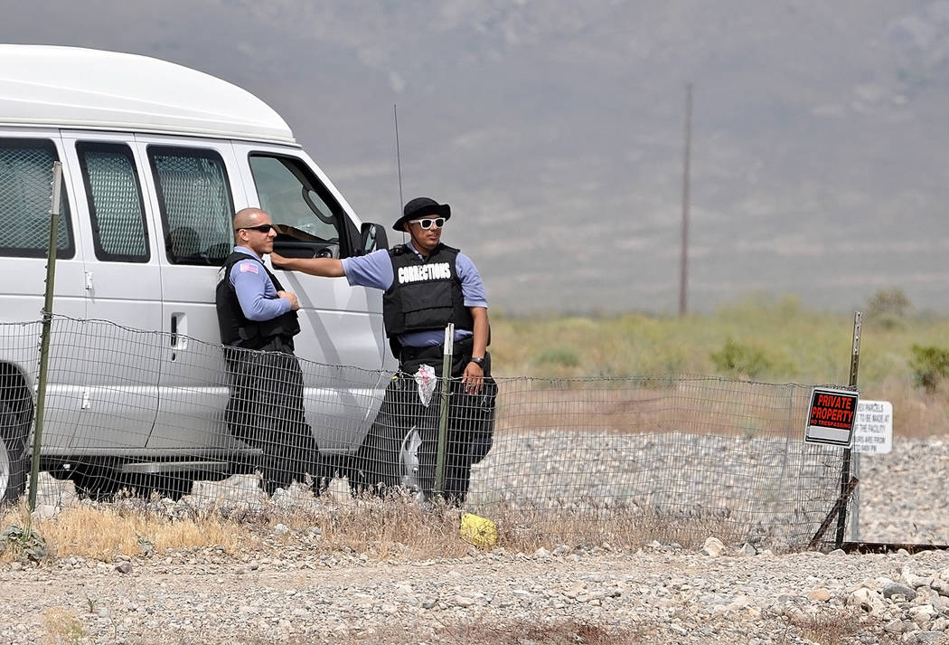Horace Langford Jr./Pahrump Valley Times  Two Nevada Southern Detention Facility officials stand watch as protesters have camped out across the street from the facility on May 5. Today marks the e ...
