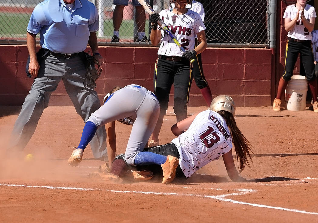 Horace Langford Jr./Pahrump Valley Times  Jackie Stobbe sliding home against Moapa Valley on May 10. On Saturday the Trojans dropped two games, 6-5 in both games, to Moapa Valley, losing the regio ...