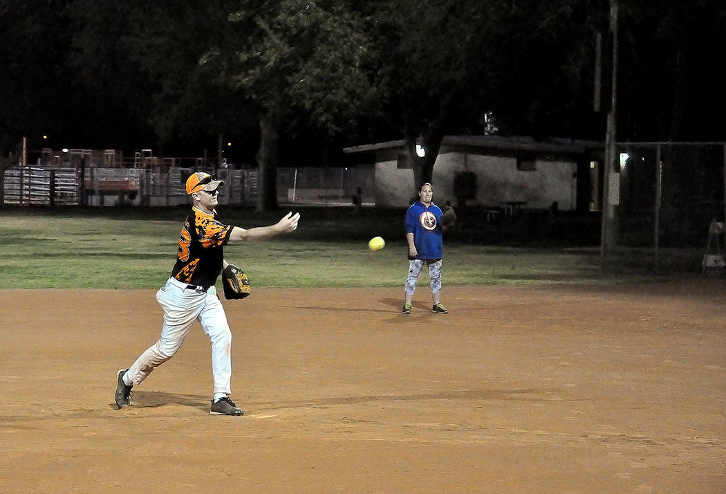 Horace Langford Jr./Pahrump Valley Times  Softball players play under the new lighting system at Petrack Park.