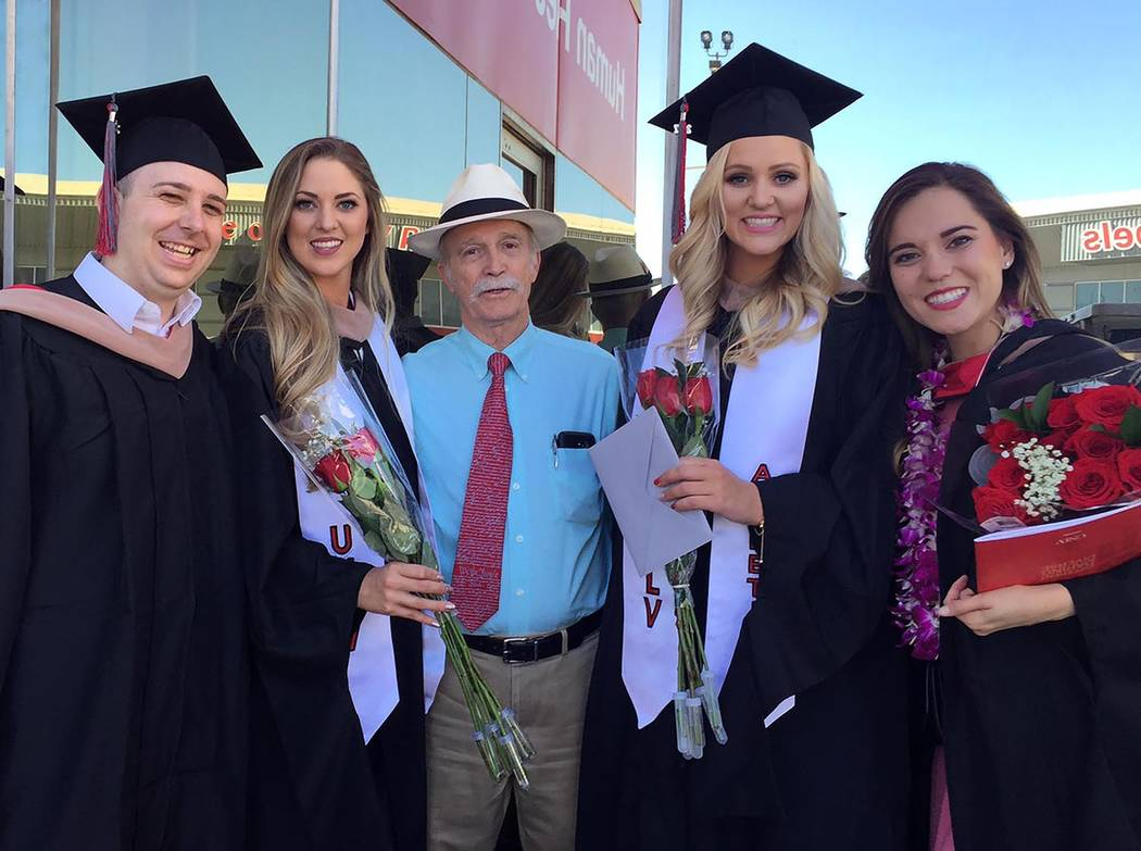 Photo is courtesy of Randall Schroeder. Retiring Beatty High School teacher Jerry Adcox is surrounded by the four MBA graduates. Left to right: Nick Gorman, Ariel Spicer, Jerry Adcox, Autumn Spice ...