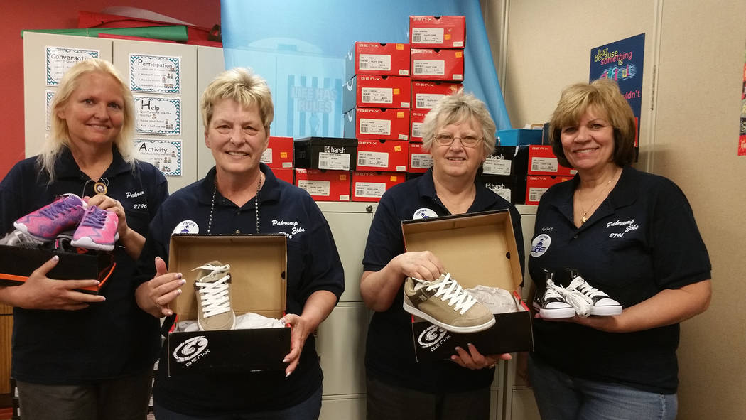 Special to the Pahrump Valley Times  Members Elks Lodge 2796 recently distributed more than 300 new pairs of shoes and socks to needy children throughout Pahrump's four elementary schools, one m ...