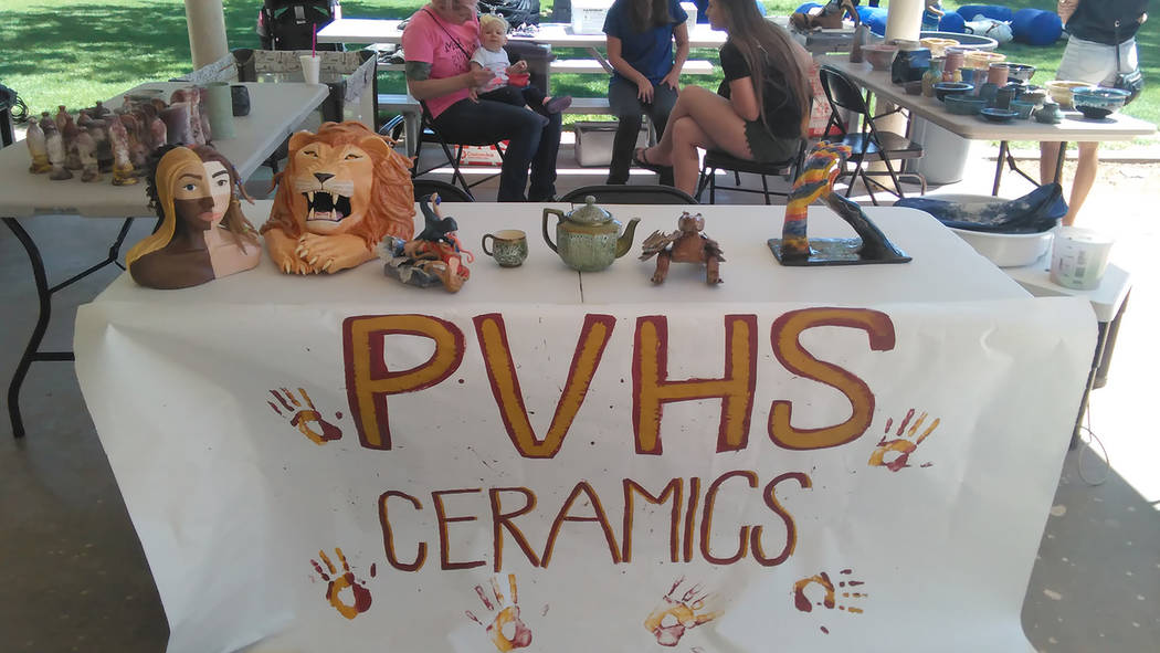 Selwyn Harris/Pahrump Valley Times  Scores of individuals turned out at Ian Deutch Memorial Park on Saturday, May 13, for Pahrump Valley High School's Music and Art in the Park Festival. The all ...