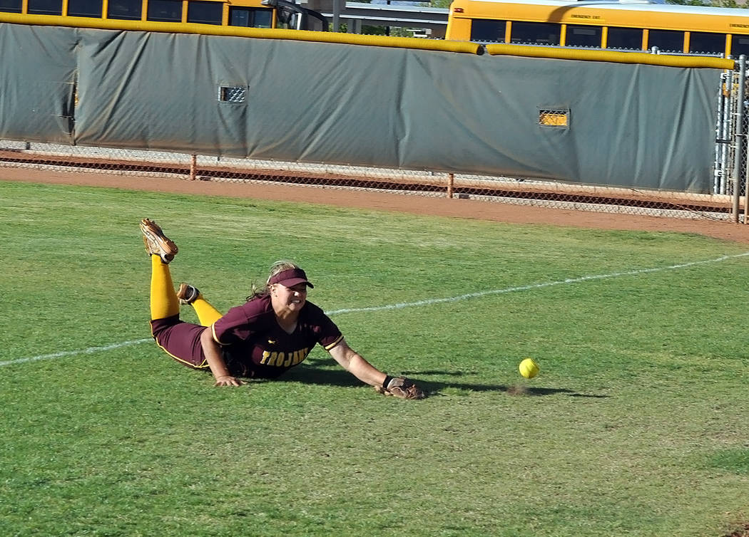 Horace Langford Jr./Pahrump Valley Times Jordan Egan dives for a ball in right field. The Trojans played three games in the state tournament, losing two to Churchill County, 10-3 and 5-3.