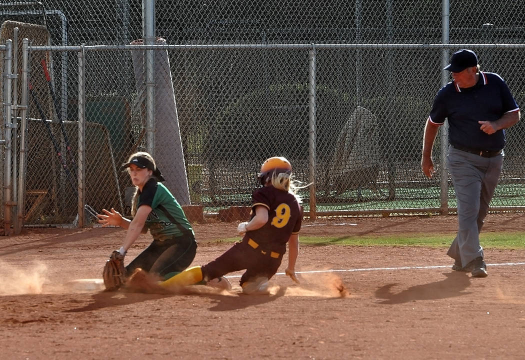 Horace Langford Jr./Pahrump Valley Times Evandy Murphy stealing third against the Churchill County Greenwave on May 18, which was the Trojans' first loss in the state tournament.
