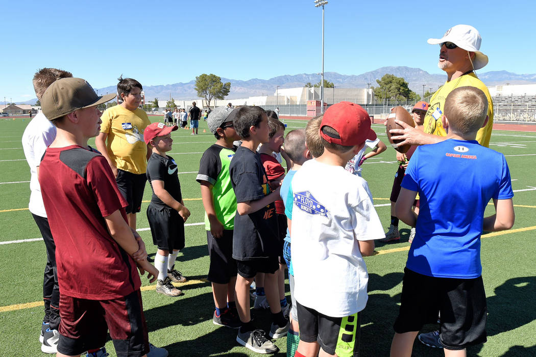 Peter Davis/Special to the Pahrump Valley Times Joe Clayton, Trojans football coach, imparts his wisdom on young football minds at the Jr. Trojans football camp on Saturday.