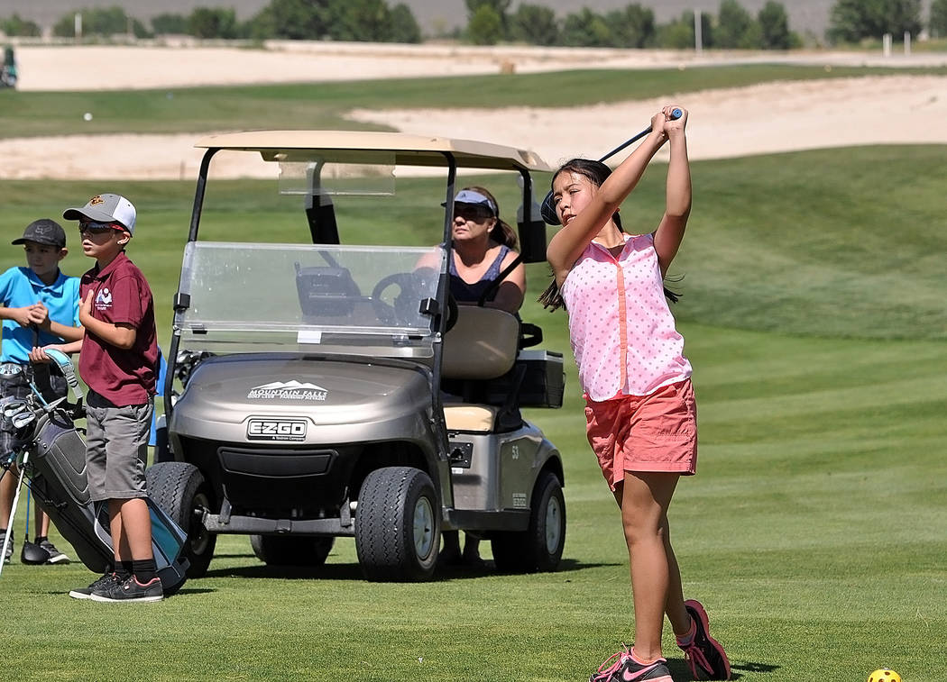 Horace Langford Jr./Pahrump Valley Times Shania Hopkins drives the ball last year at Mountain Falls during a junior golf tournament. Junior golf is for kids from 6-17 and it allows kids to learn t ...