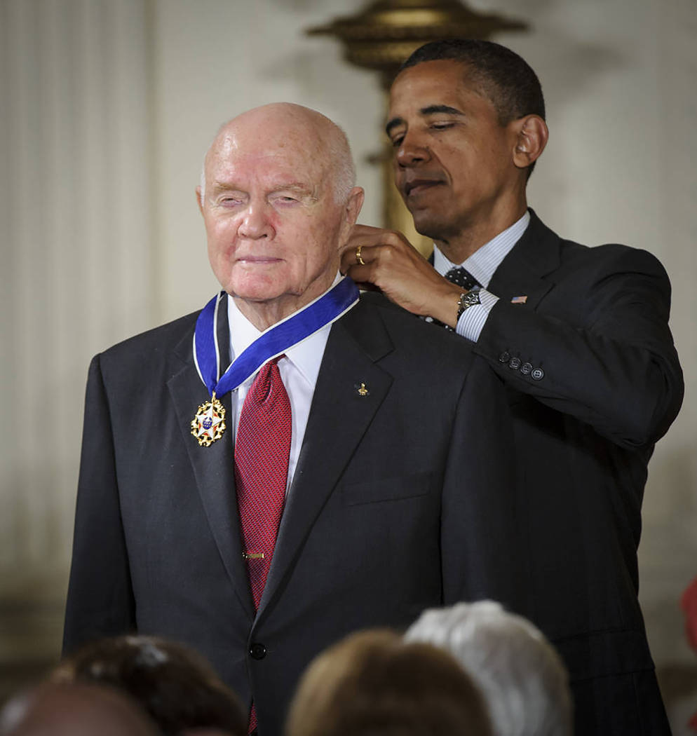NASA/Bill Ingalls President Barack Obama presents former Marine Corps pilot, astronaut and retired U.S. Sen. John Glenn of Ohio with a Medal of Freedom on May 29, 2012, during a ceremony at the Wh ...