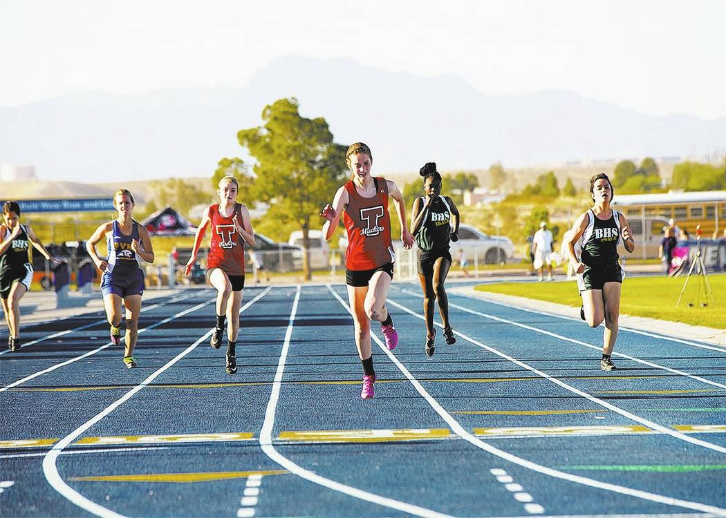 Skylar Stephens/Special to the Times-Bonanza & Goldfield News Katelyn Maurer (left) taking second and Delaney Friel taking first in the 400-meter run. Friel won two individual championships in ...