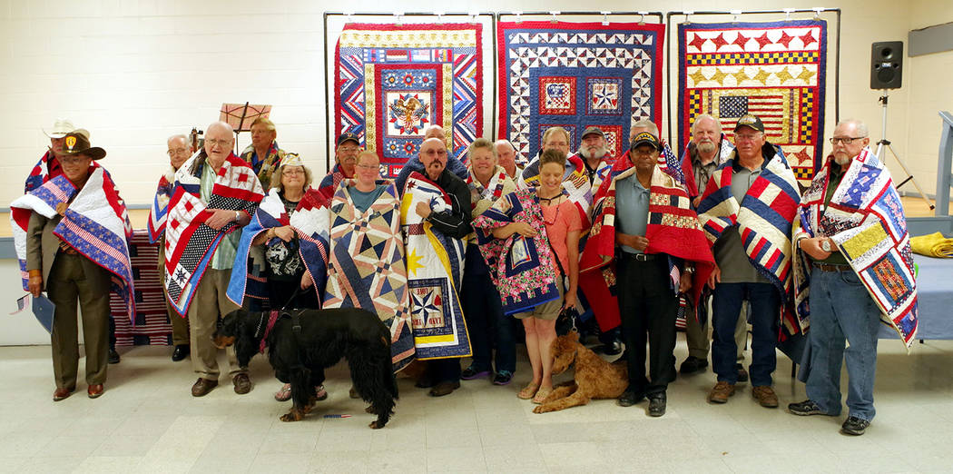 Special to the Pahrump Valley Times  More than 20 area veterans were honored with custom handmade quilts on Saturday during the annual Quilts of Valor ceremony at the Bob Ruud Community Center in  ...
