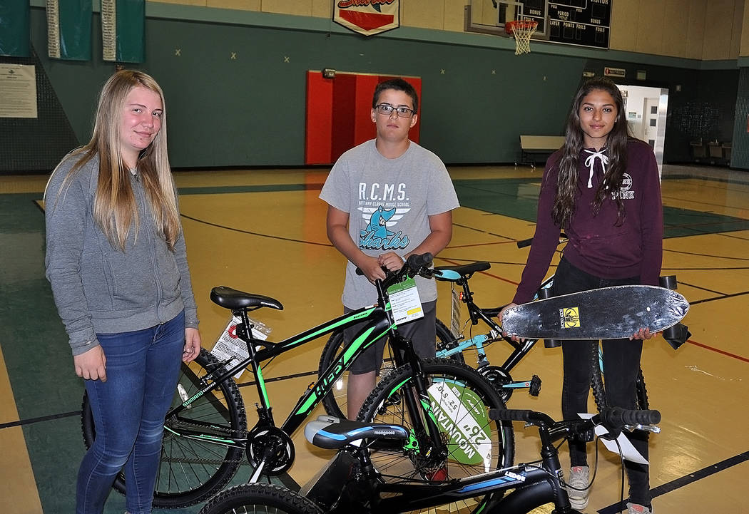 Horace Langford Jr./Pahrump Valley Times  The three students who won a bike at Rosemary Clarke Middle School for perfect attendance, from left to right, seventh grader Alyssa Holmes, sixth grader  ...