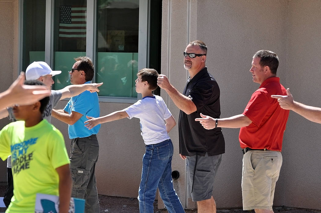 Horace Langford Jr./Pahrump Valley Times  Eighth graders at Rosemary Clarke Middle School say goodbye to science teacher Joe Clayton as the students walk through the gate to the school for the las ...