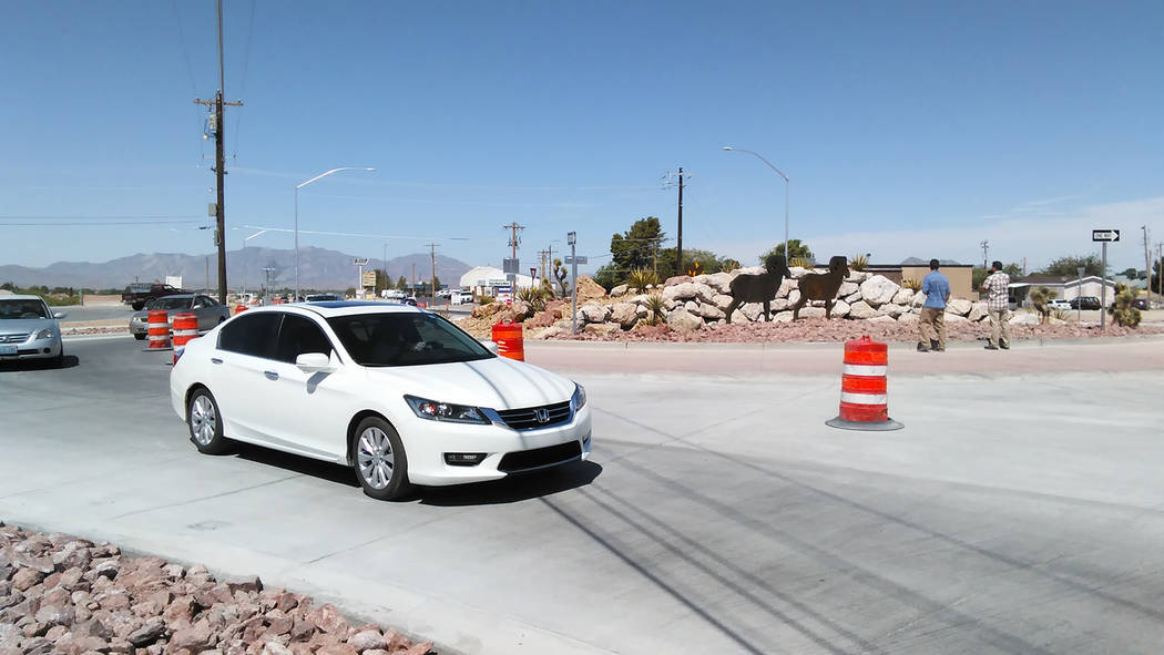 Selwyn Harris/Pahrump Valley Times  Motorists began driving through the newly constructed roundabout at Highway 372 and Pahrump Valley Boulevard late Thursday morning. An official grand opening ce ...