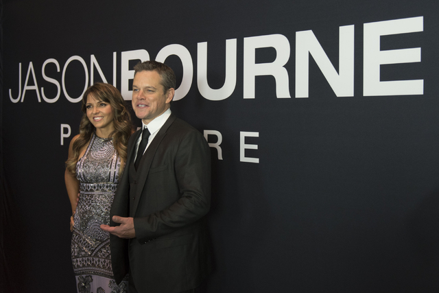 """Jason Ogulnik/Las Vegas Review-Journal Matt Damon, right, and his wife, Luciana Barroso, pose on the red carpet ahead of the Las Vegas premiere for the film """"Jason Bourne"""" at Caesars Palace, July  ..."""