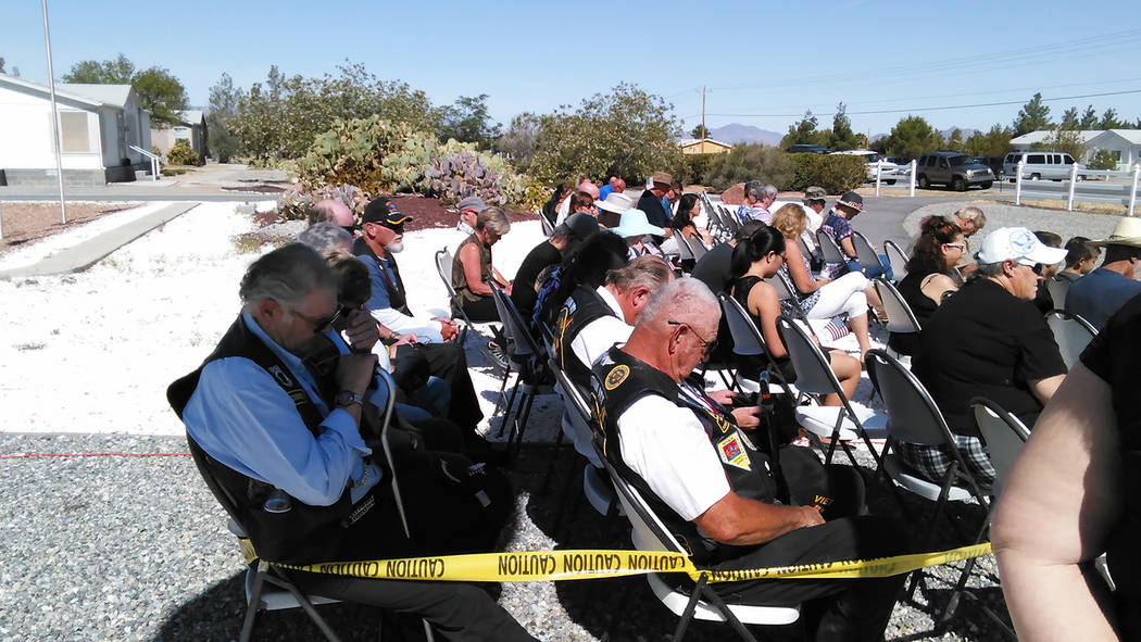 Selwyn Harris/Pahrump Valley Times  Area veterans bow their heads during a prayer at Monday's Memorial Day ceremony at G.G. Sweet Memorial Park on Gamebird Road. The observance drew more than 10 ...