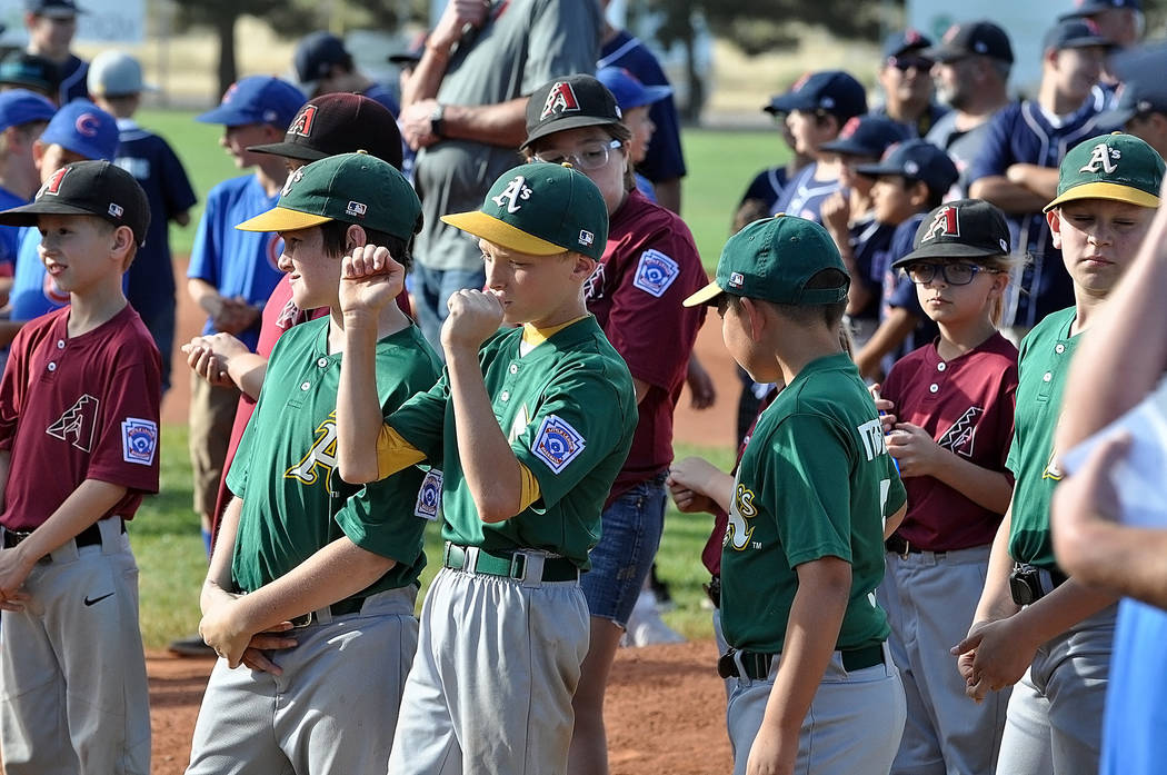 Horace Langford Jr./Pahrump Valley Times The P-Town Little League Minors Division champs, the A's, wait for the festivities to begin. They received a ring for all their hard work.