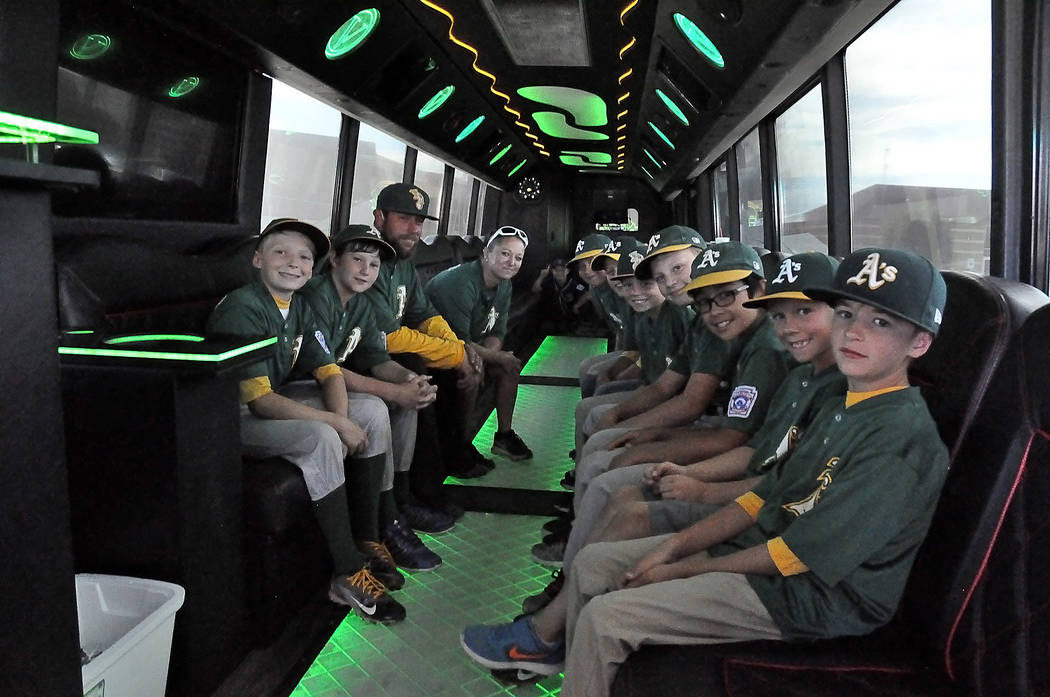 Horace Langford Jr./Pahrump Valley Times The P-Town Little League Minor Division champions sitting in their party bus. The bus was a surprise from one of the mothers, Stephanie Foster, who got all ...