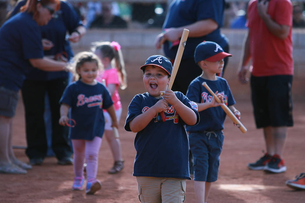 Special to the Pahrump Valley Times The smile on this little leaguer says it all - trophies are out, toy bats are in. According to Lou Banuelos, the league has given out participation trophies and ...