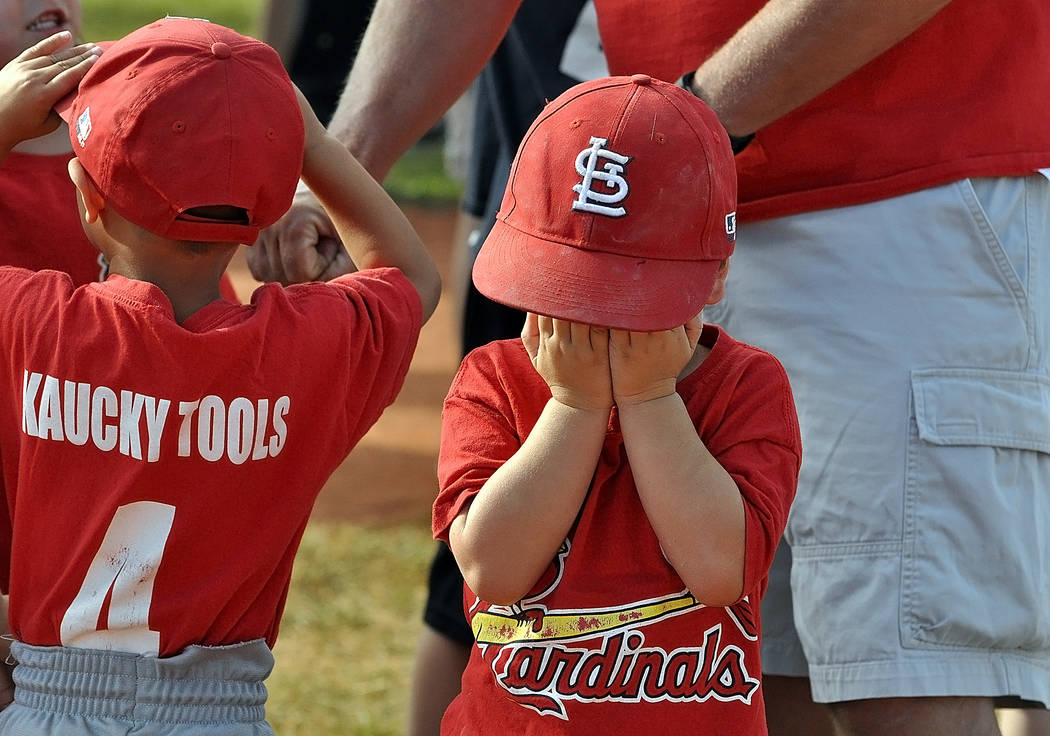 Horace Langford Jr./Pahrump Valley Times The ceremony marked the end of baseball and for this little guy, this was a sad day.