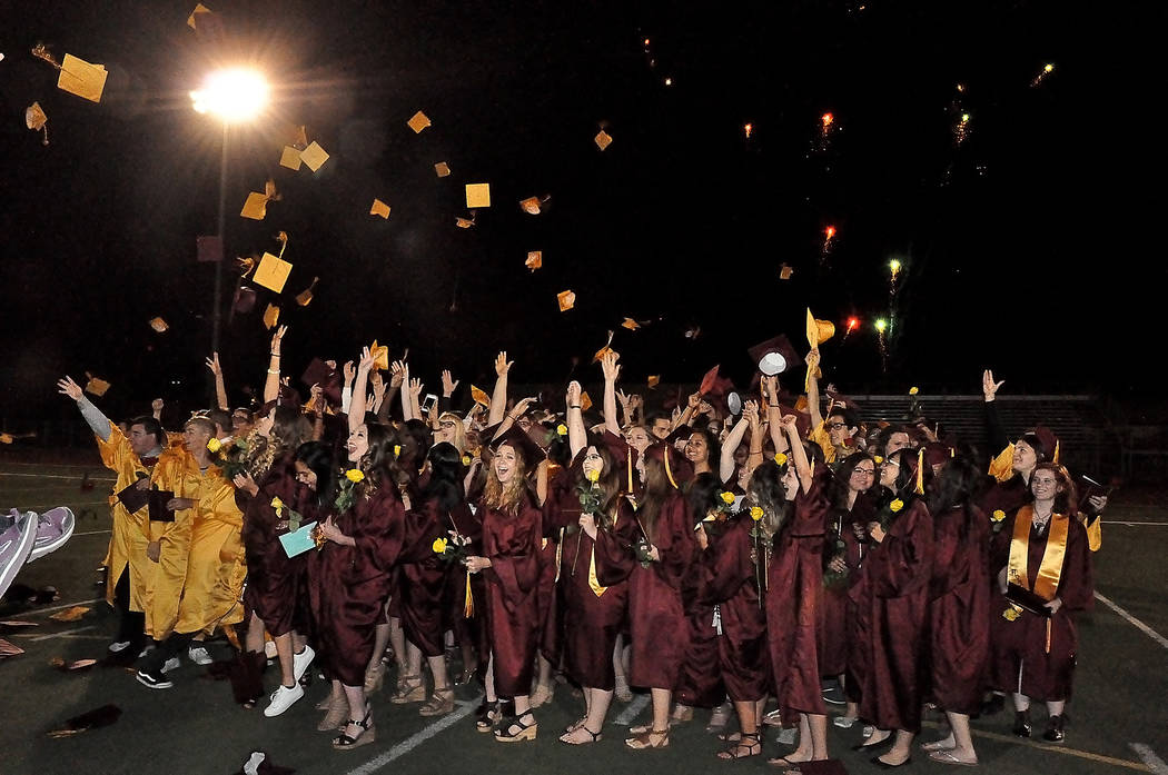 Horace Langford Jr./Pahrump Valley Times  Members of the Pahrump Valley High School Class of 2017 celebrate amid fireworks as they graduate on May 26.